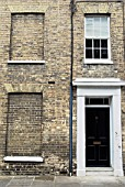 Victorian terrace townhouse with bricked out windows, Hadleigh, Suffolk, UK