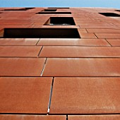 Gazzano House, a commercial and residential block clad in Cor-Ten, the steel alloy which includes copper so that it rusts, forming a patina that protects the building, Farringdon Road, Central London, UK