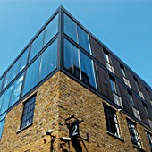 Modern office roof extension to converted factory building, The Borough, South London, UK