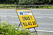 Temporary sign displaying Highways Agency telephone number on the M1, Hertfordshire, UK
