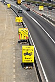Roadwork signs on the M1 motorway, Hertfordshire, UK