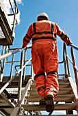 Workman in protective overalls, aggregate plant, Greenwich, South-East London, UK