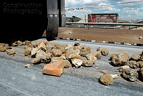 Aggregate rubble on a conveyor belt at a construction materials and recycling plant Greenwich SouthE