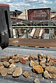 Aggregate rubble on a conveyor belt at a construction materials and recycling plant, Greenwich, South-East London, UK