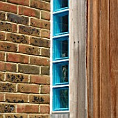 Blue glass bricks within an exterior wall