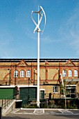 Vertical-axis wind turbine (VAWT) outside a warehouse converted to offices, Kennington, South London, UK