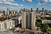 Block of flats in front of a city skyline, London, UK