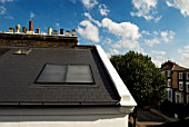 Solar panels on roof of Victorian house, Camden Town, London, UK
