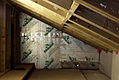Insulated wall in loft of Victorian house