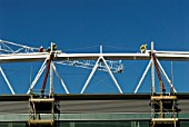 Construction workers fix roof truss to roof of Centre Court, All England Lawn Tennis Club, Wimbledon, London, UK, 2008.