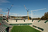 View from new No. 2 Court as two cranes work in tandem to lift roof trusses on to fixed roof of Centre Court, All England Lawn Tennis Club, Wimbledon, London, UK, 2008