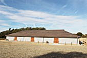 Sworders auction house, Stansted Mountfitchet, Essex. It is the largest straw bale building in the United Kingdom and incorporates solar heating, bio-fuel boiler and uses rainwater harvested from its cedar roof.