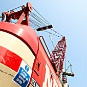 Abstract view of a mobile crane with safety sign.