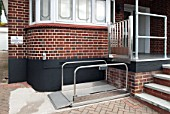 Wheelchair lift access to the front door of a doctors surgery, Benfleet, Essex, UK