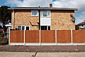 Wooden boundary fencing surrounding 1970s built housing, Benfleet, Essex, UK