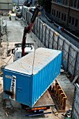 Storage container being lifted onto a back of a truck during construction of The Shard at London Bridge, UK