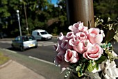 Flowers marking road accident, UK.