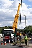 Mobile crane blocking access to road, Manchester, UK.