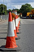 Red cones blocking access during road work.