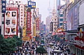 Nanjing Road, Shanghai, China. Pedestrianised Shopping Street with crowd.