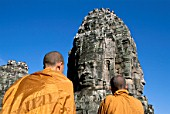 Monks at Temple Towers, Bayon, Angkor Thom temple, Siem Reap, Cambodia. UNESCO World Heritage.
