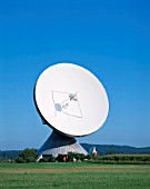 View of a satellite dish, Satellite Communications Station, Raisting, Bavaria, Germany. The station is used by Deutsche Telekom: A total of 18 parabolic dishes facing into space maintain satellite contact.