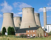 Coal Fired Power Station Cooling Towers with House, Radcliffe on Trent, Nottinghamshire, England