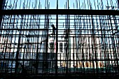 Workers erecting scaffolding for the construction of a curtain wall at the new HQ building of Chinese travel agent, CTYS. Central Beijing