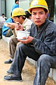 Construction workers eating lunch on site in Beijing.