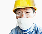 Chinese construction worker with dust mask.