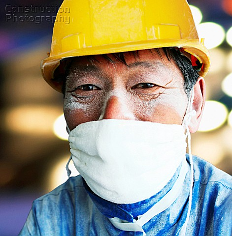 Chinese construction worker with dust mask