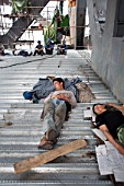 Chinese construction workers resting on site