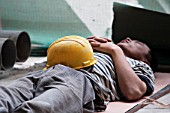 Chinese construction worker resting on site