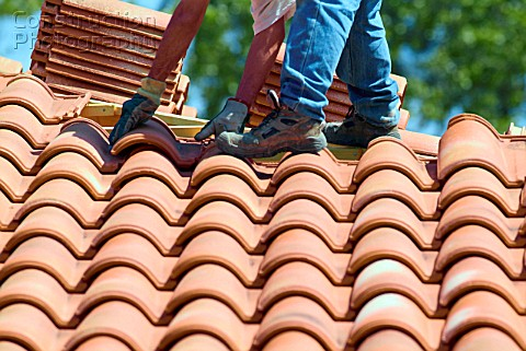 French roof tiles being layed