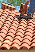 French roof tiles being layed.