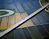 Aerial view of motorway viaduct over arable land. Portugal, Europe.