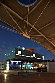 External view of front of Peckham Library including walkway canopy at dusk, London, UK