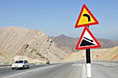 Road signs for steep hill in Oman