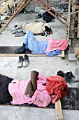 Construction workers having a sleep on site, Muscat, Oman