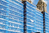 Blue safety netting and scaffolding during refurbishment of the Port of Liverpool building, Liverpool, United Kingdom