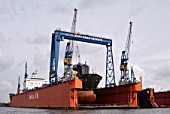 Ship in for repair in floating dry dock '16', Hamburg, Germany