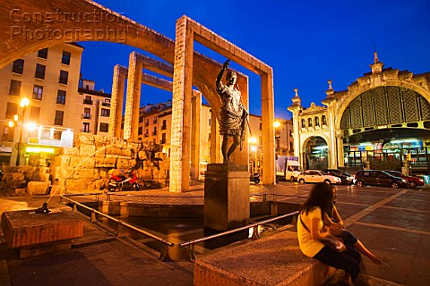 Statue of Caesar Augustus in front of Central Market dusk Zaragoza Spain