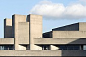 The National Theatre located on the south bank of the river Thames in London is another major example of Brutalist architecture. Designed by architect Sir Denys Lasdun and opened in 1976.