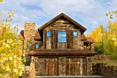 Private residence in Jackson Hole Wyoming. Home was photographed during peak fall foliage colors. The home features reclaimed barn wood on the exterior and interior, as well as corrugated metal roof top.