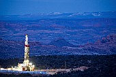 Dusk view of natural gas drill rig near Dead Horse Point in SE Utah, USA Though this rig is on land managed by the Bureau of Land  Management, the surrounding area is a checker board of National Park and National Forest Land.