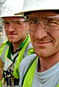 Portrait of twin construction workers, London, UK