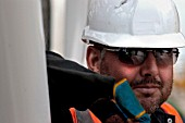Portrait of construction worker, Terminal 5, Heathrow Airport Construction, London, UK