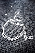 Disabled sign laid in paving