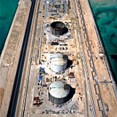 Aerial view LNG Storage tanks under construction in Qatar Liquid Natural Gas refinery near Doha.