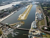 Aerial view City Airport from the east. Old Royal Docks, University of East London, Thames Barrier,Excel
